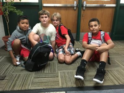 4 boys happy to be in school