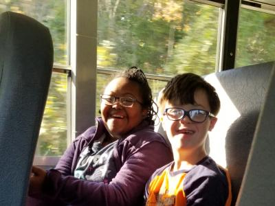 Students on a bus for a field trip